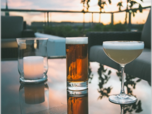 Cocktails on table with sunset in background