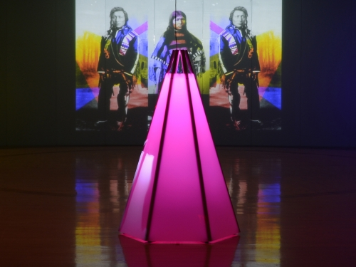 Art installation showing pink neon tipi