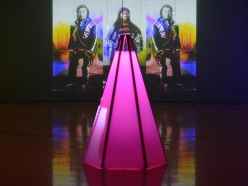 Art installation showing pink neon tipi