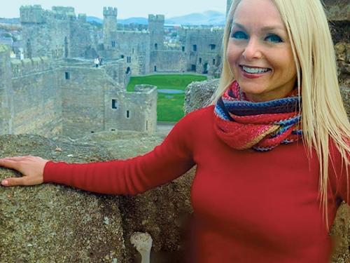 Christine van Blokland getting curious at Caernarfon Castle in Wales (Curious Tr