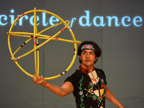 Dancer with yellow hoops