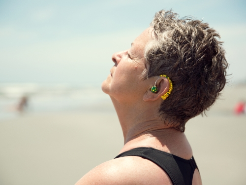 Woman wearing bedazzled hearing aid
