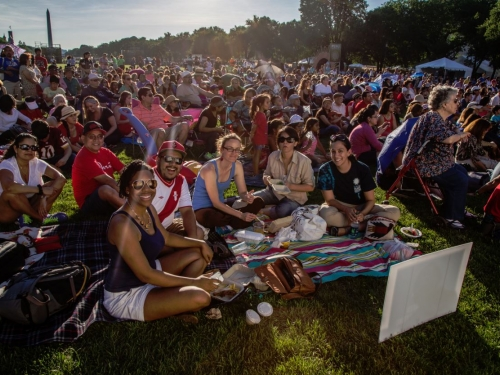 Festival goers sitting on blankets on the Mall