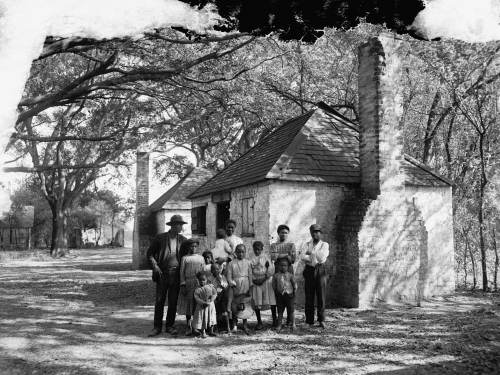 Photo of family in front of house