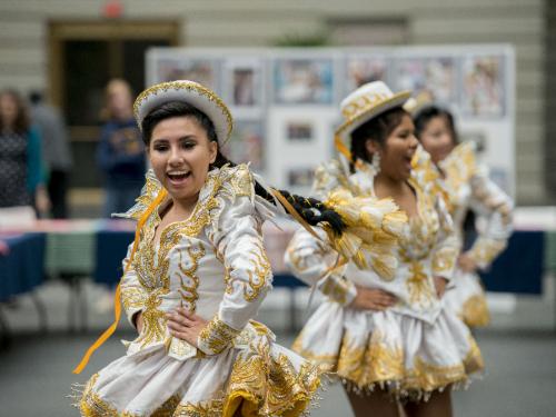 Costumed dancers in performance