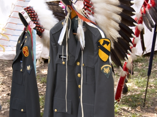 Military uniforms adorned with Feather headdresses