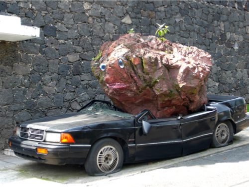 Car being crushed by rock