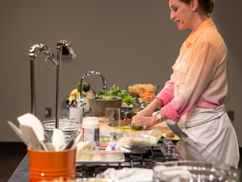 Woman giving cooking demonstration