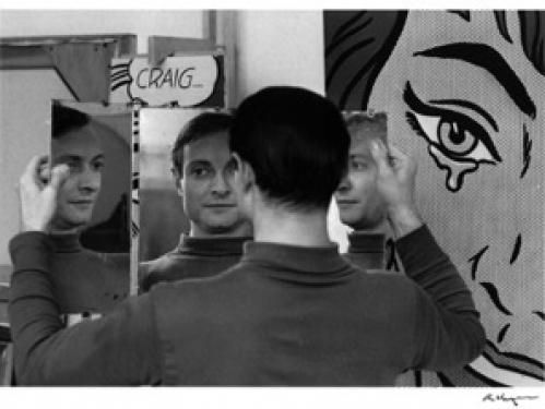 Artist Roy Lichtenstein in front of his paintings