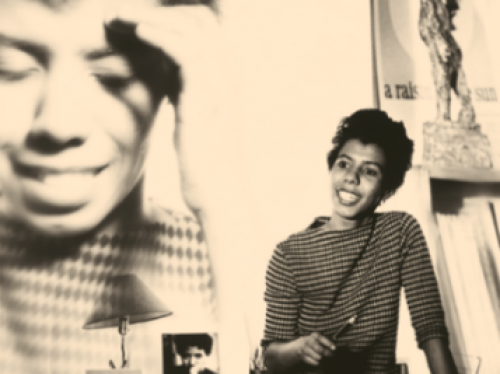 Lorraine Hansbury in front of large photo of herself
