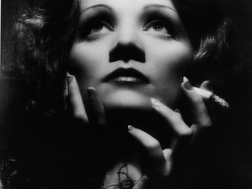 Black and white studio portrait of Marlene Dietrich as Shanghai Lily