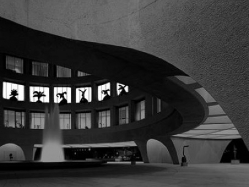 Sketch of darkened Hirshhorn with projected images