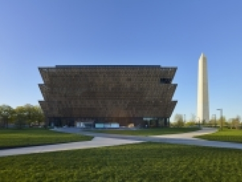 NMAAHC exterior with Washington Monument in background