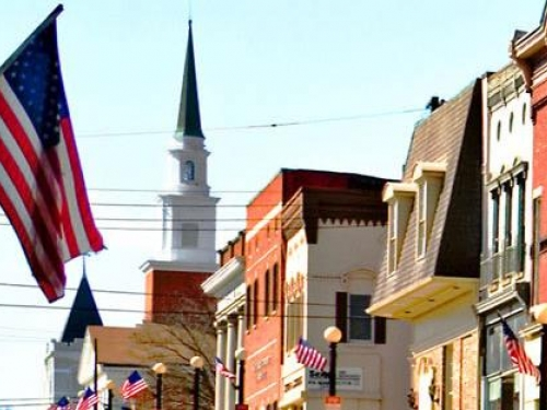 Small town street with American flag