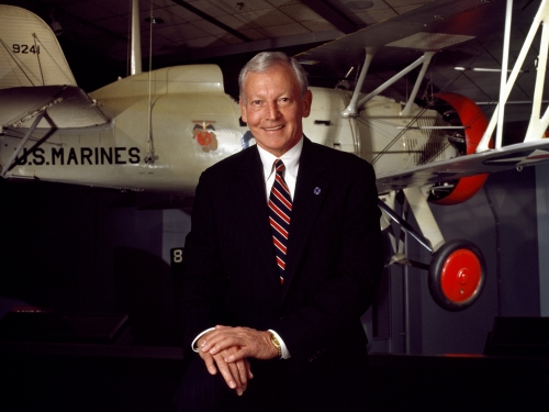 Jack Dailey posed in front of plane