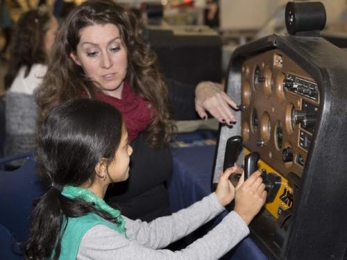 female student using flight simulator