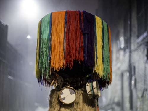 Person obscured by colorful Native costume