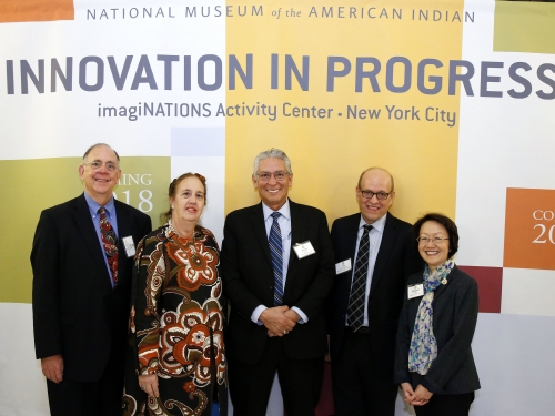 Group shot of dignitaries in front of Innovation in Progress banner