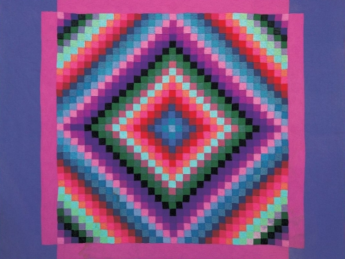 Vibrant quilt with abstract, square design