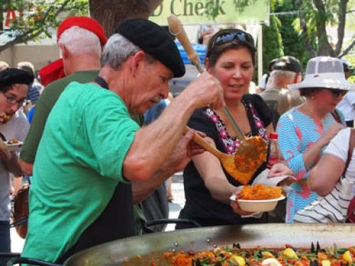 Man serving traditional Basque food at Jaialdi