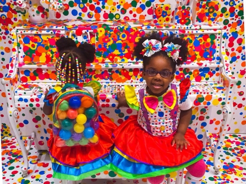 Two young girls in bright polka dot clothes in bright polka dot exhbition