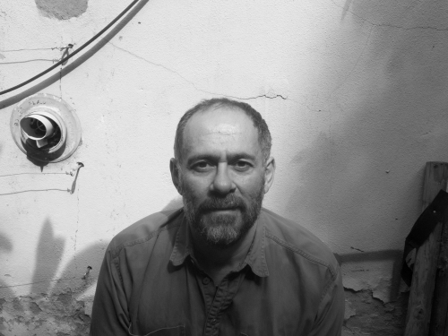 Black and white photo of artist