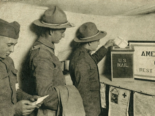 WWI soldiers mailing letters at Red Cross station