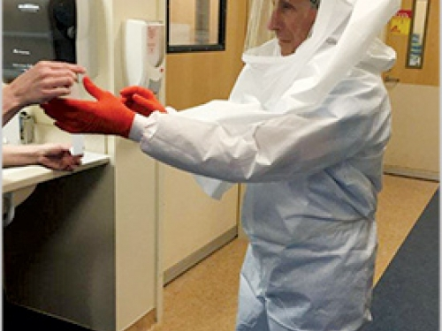 Dr Anthony Fauci in protective suit