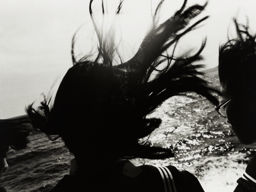 Black and white photo of girl in silhouette