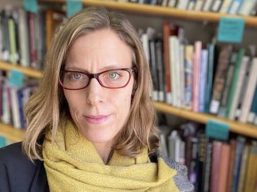 Headshot of woman in front of bookcase