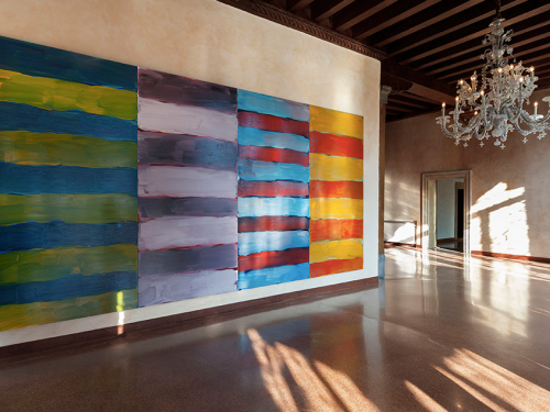 Large painting with multicolored stripes