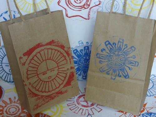 paper bags stenciled with sun designs