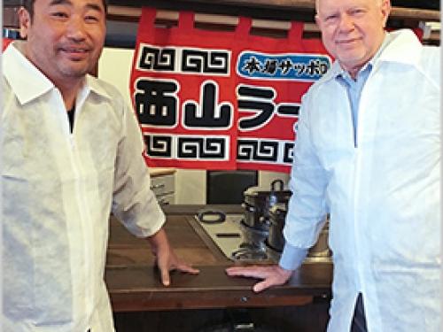 Daisuke Utagawa and Rudy Maxa at sushi bar