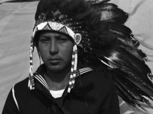 Close up of young man in Navy uniform wearing a headdress