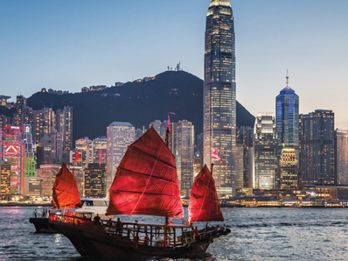 Traditional junk boat sailing in Victoria Harbour, Hong Kong