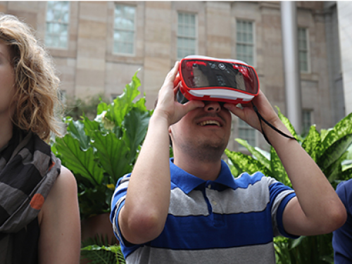 Three people using virtual reality viewers