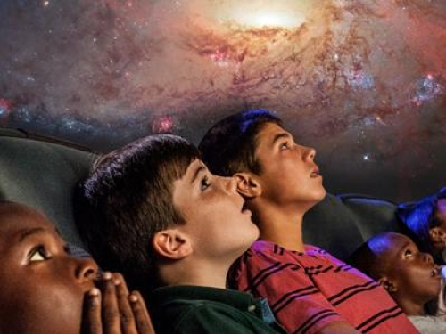 Students watching a planetarium show.