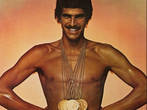 Mark Spitz in Speedo wearing gold medals