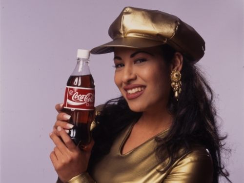 Singer Selena with bottle of Coke