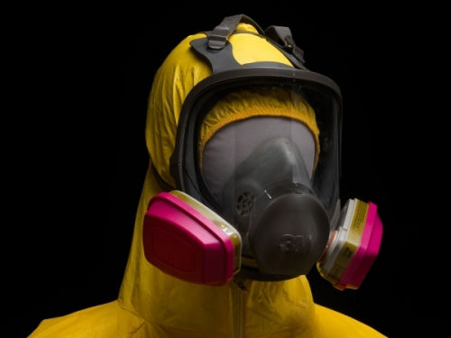 yellow Tyvek suit and gas mask