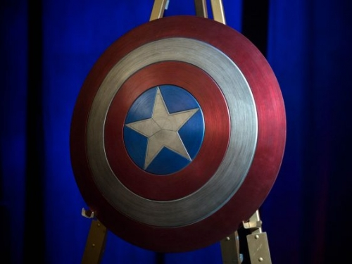 red white and blue shield with white star