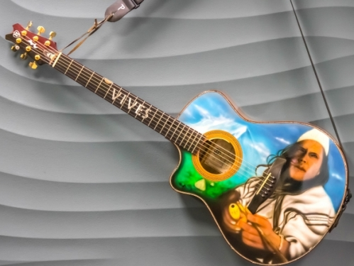 Guitar with airbrushed portrait of Carlos Vives