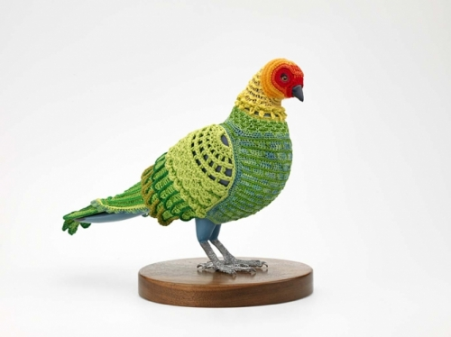 brightly colored woven sculpture of bird