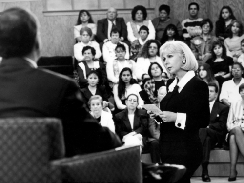 B&W photo of Saralegui interviewing guest in front of an audience