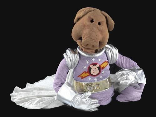 Pig Muppet in a space suit with a silver cape.