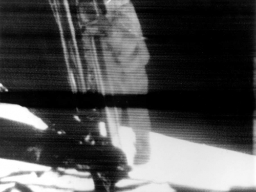 Apollo 11 astronaut Neil Armstrong climbs down the ladder of the lunar module Eagle to take the first steps on the lunar surface