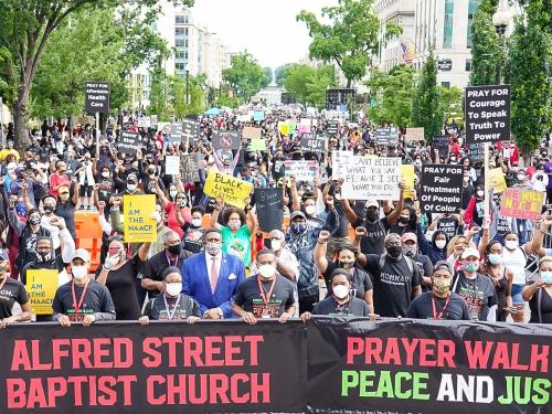 People walking in prayer.