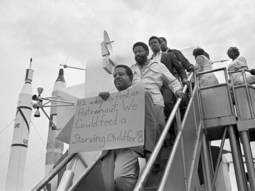 Rev. Abernathy, Hosea Williams, and other SCLC Poor People's Campaign members march through the lunar lander