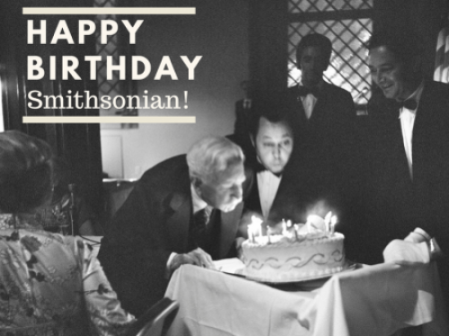 Historic photo of a man blowing out candles.
