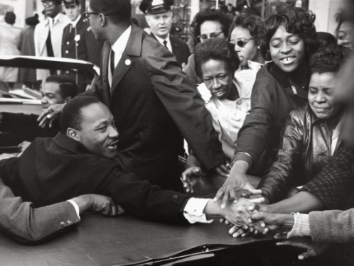 Martin Luther King Jr. surrounded by supporters